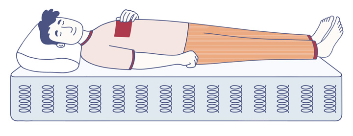 Man Sleeping On An Innerspring Mattress