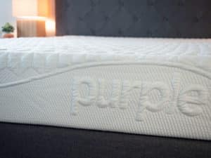A mattress in close up on a bed frame