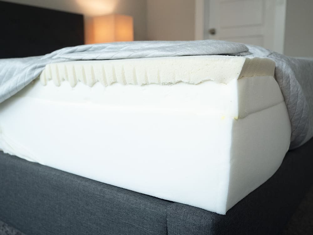 A bed is opened to show its components.
