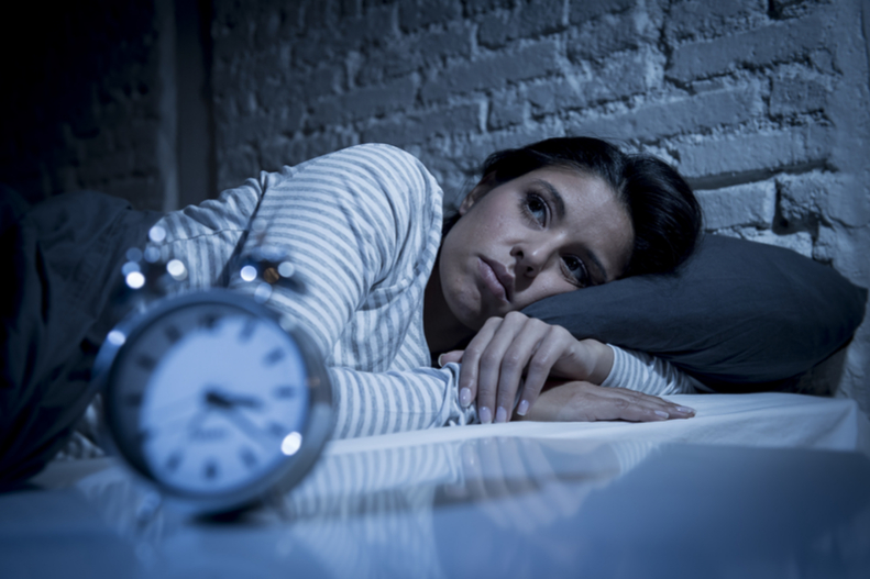 A young woman cannot sleep.