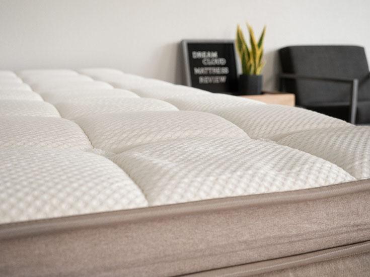 A close up of a pillow top mattress.