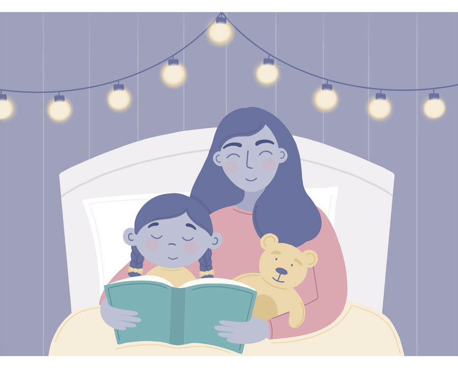 Woman reading a bedtime story to her daughter