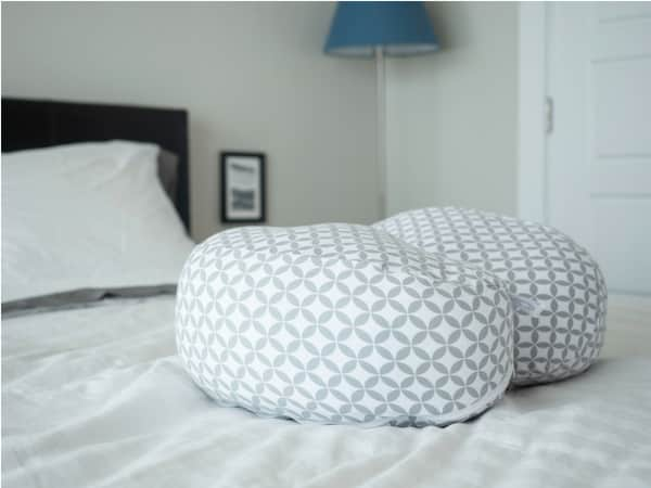boppy pillow on bed