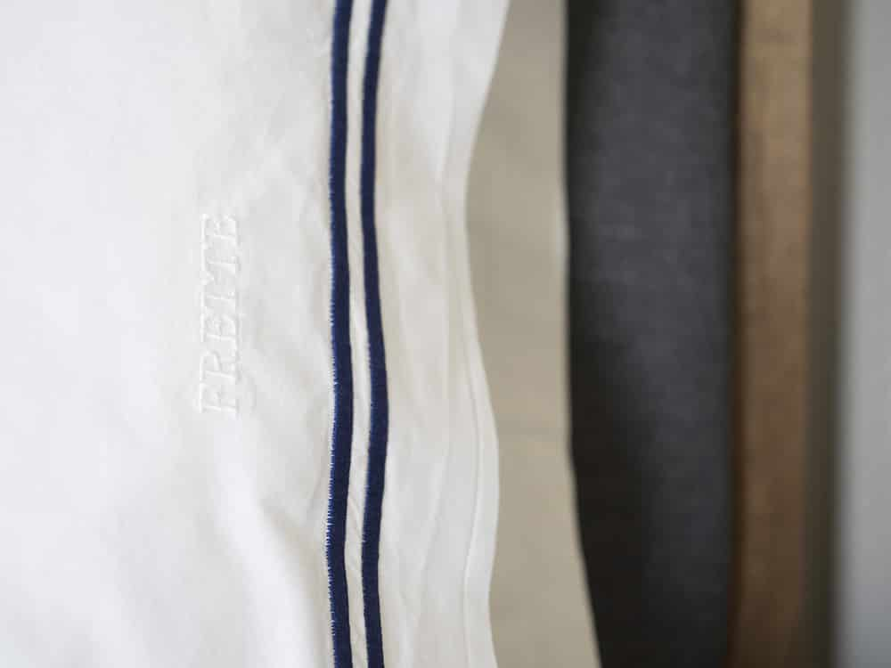white pillowcase with navy embroidery