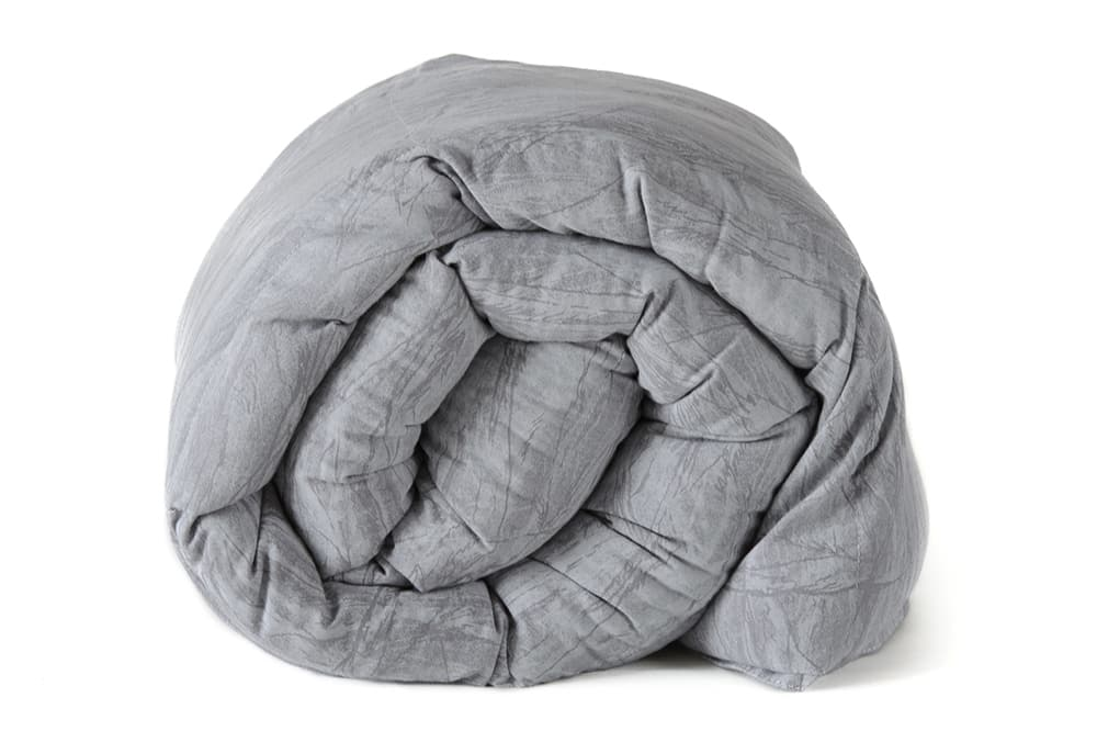grey weighted blanket wrapped up