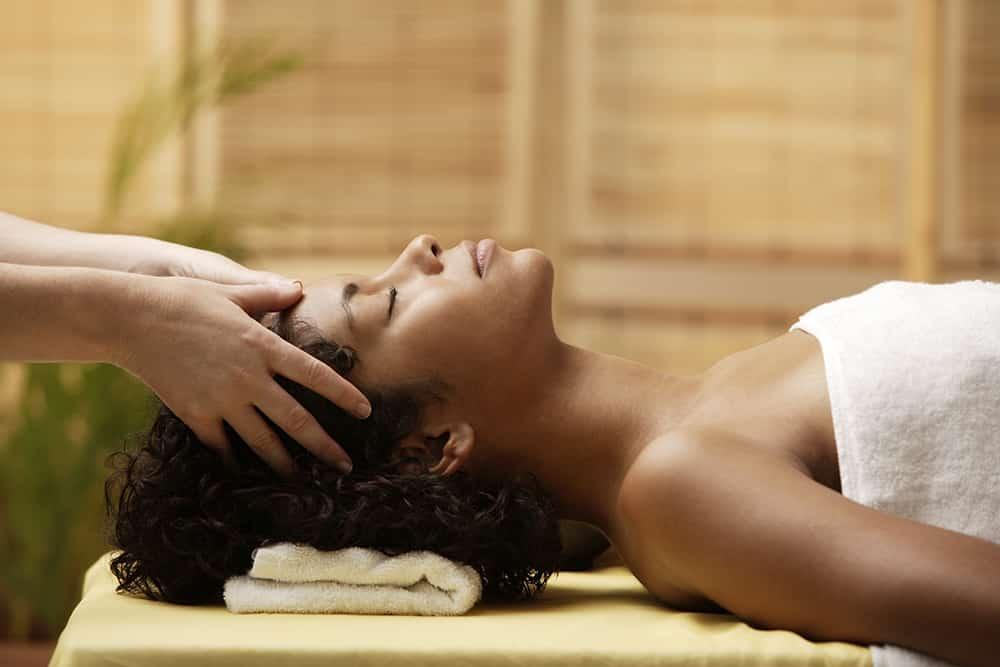 Woman gets her head massaged