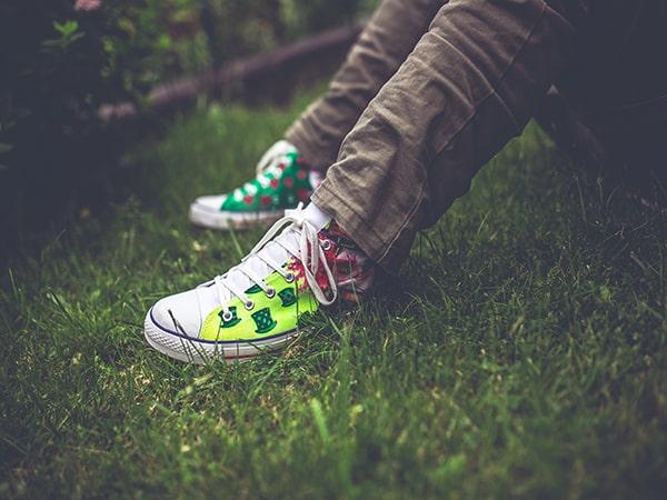 teenager feet in grass