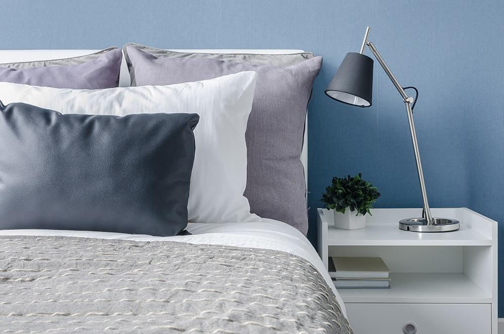 Bed in blue bedroom