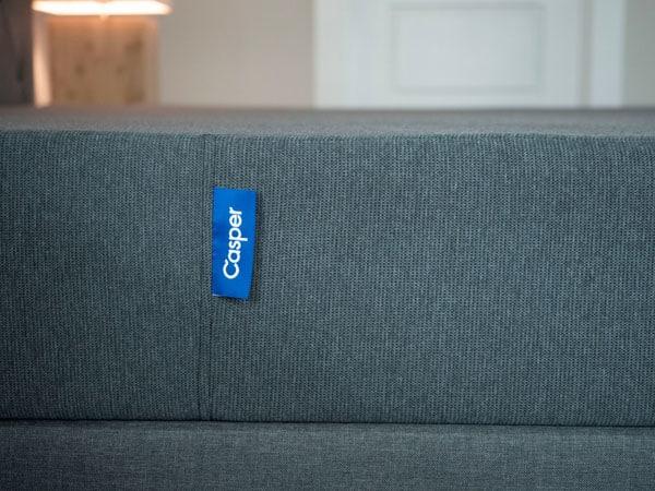 A mattress in a modern bedroom.