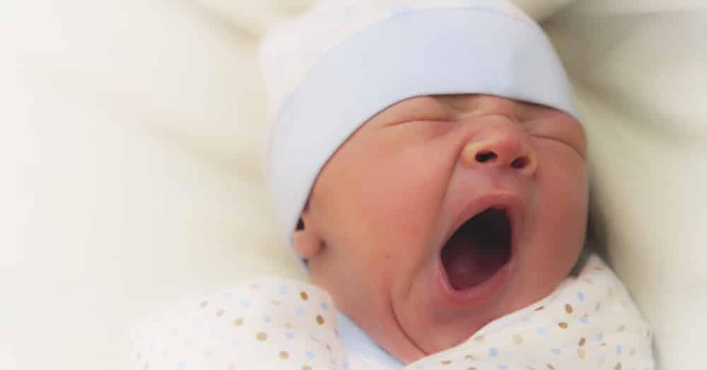 A baby yawns.