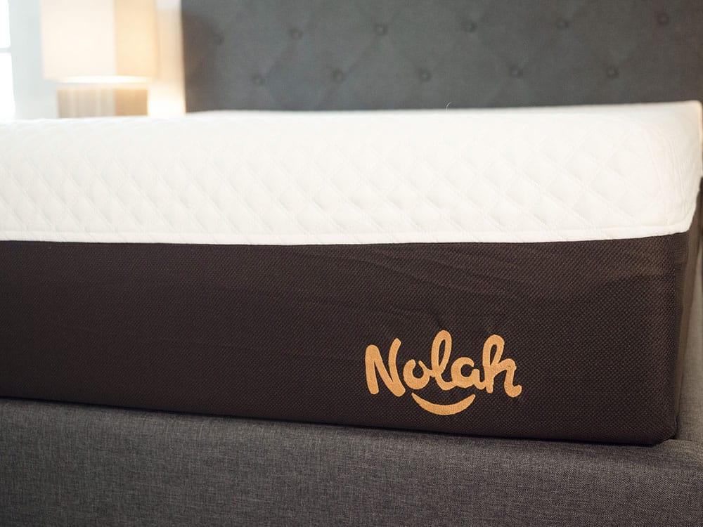 A side view of a mattress.