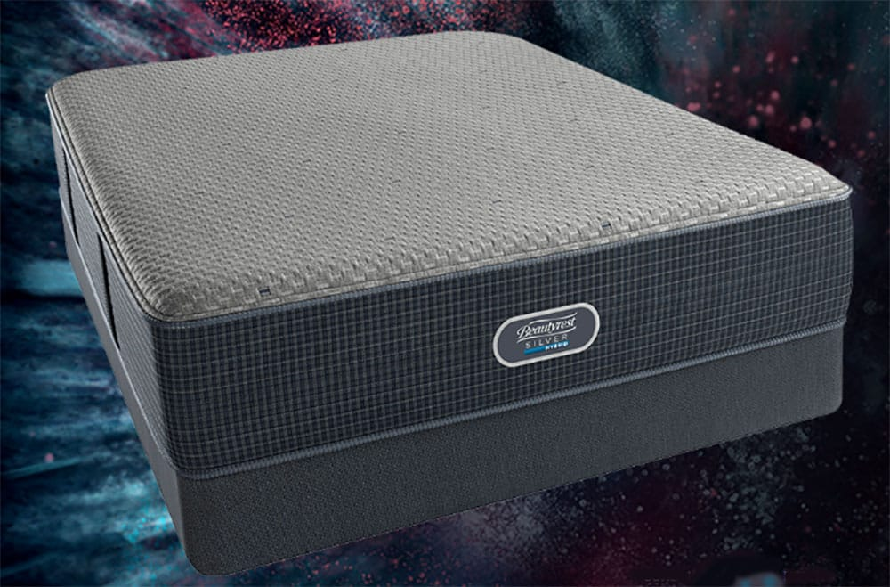 A hybrid mattress on a blue background.