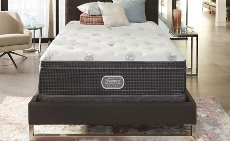 A mattress sits on a modern foundation.