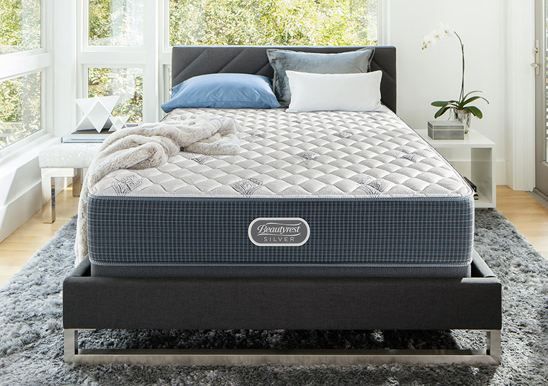 A mattress in a high-end bedroom.