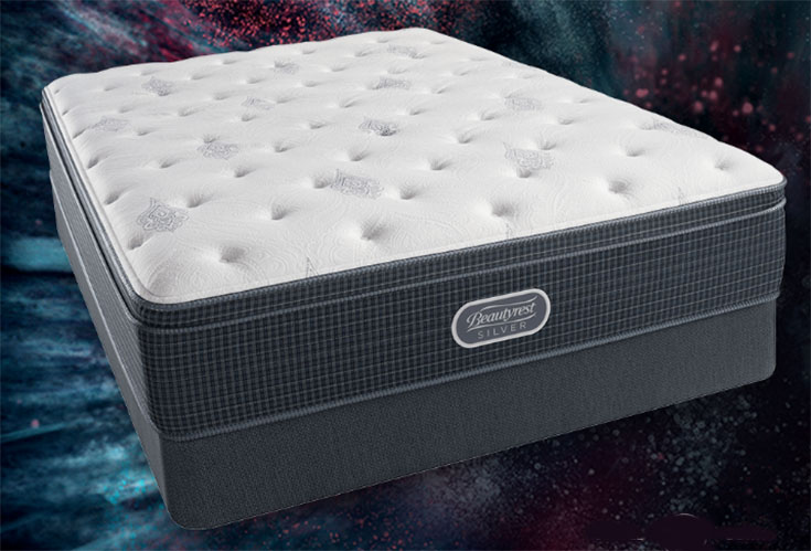 A mattress on a starlit background.