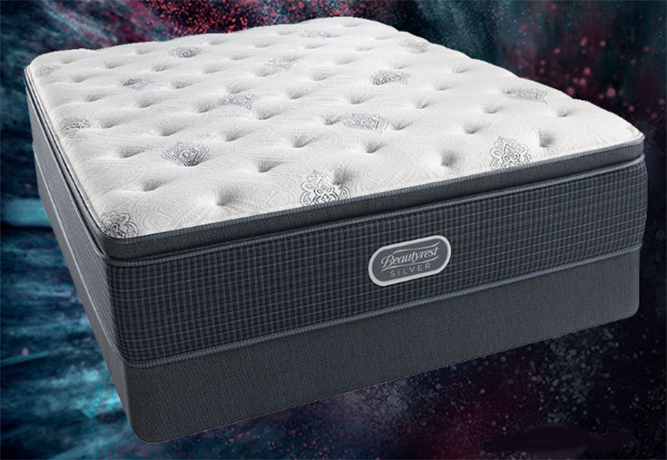 A mattress on a starlit backdrop.
