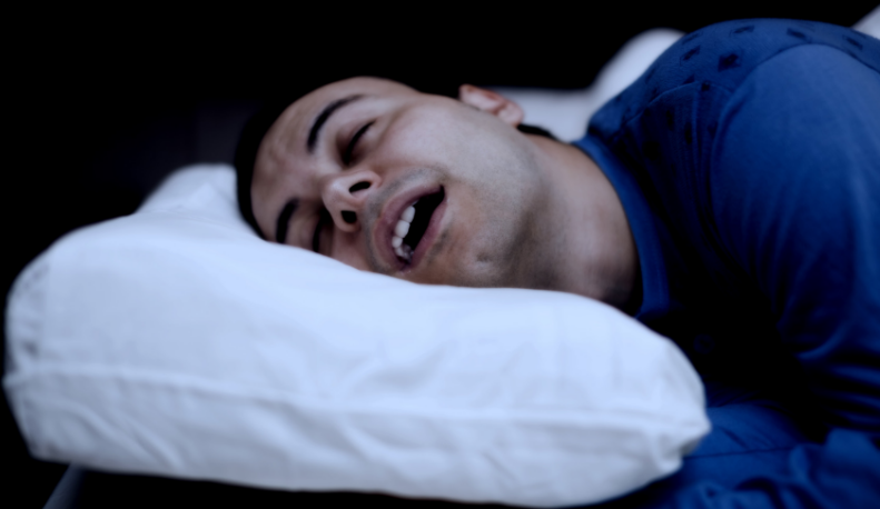 Man sleeping soundly on bed