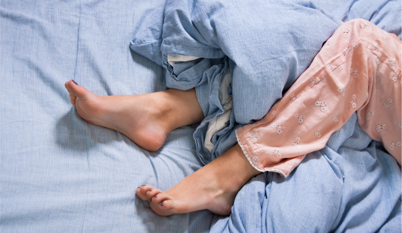 Woman's legs on bed