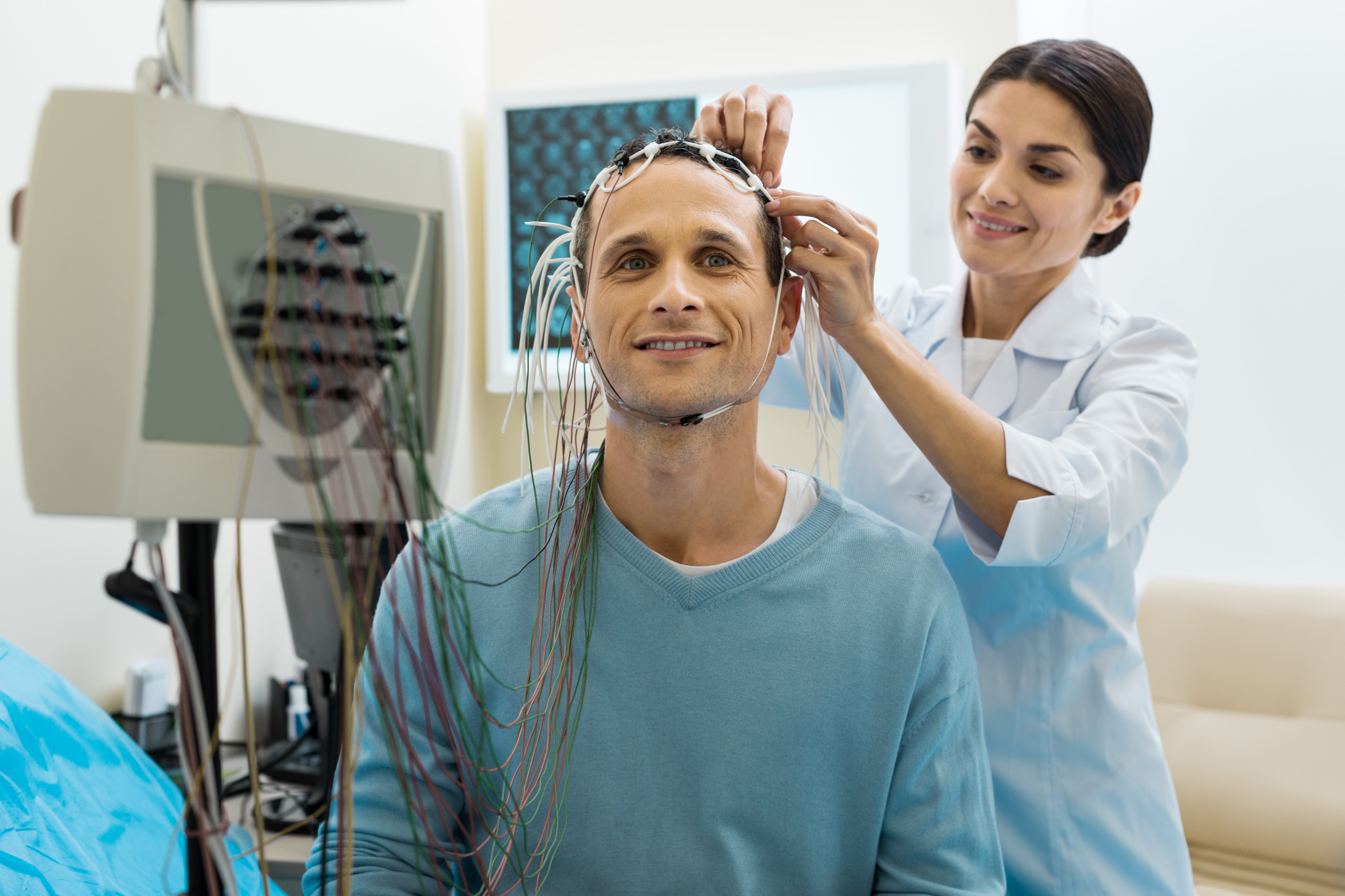 Doctor applying electrodes to research patient