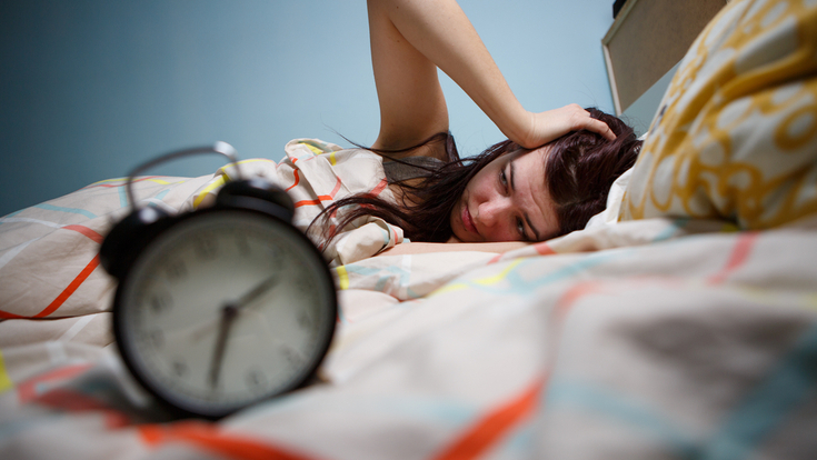 A woman has difficulty sleeping.