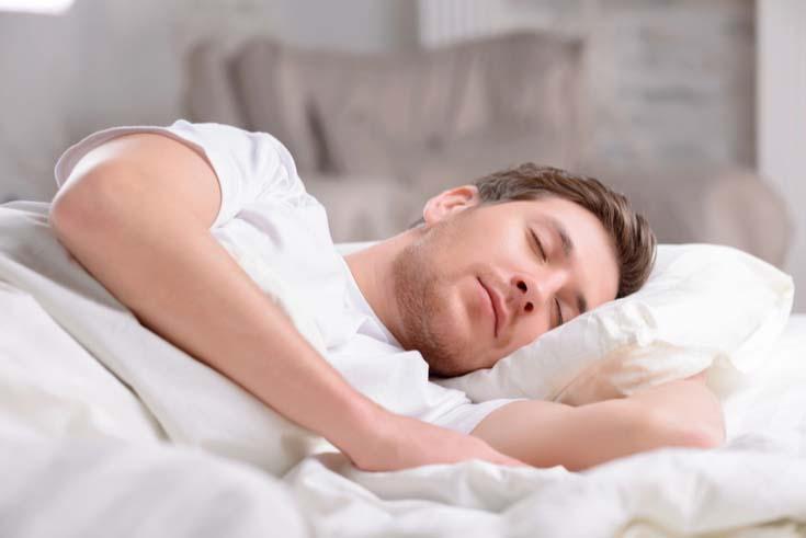 A man sleeps soundly.
