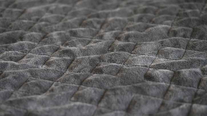 A close up of a weighted blanket.