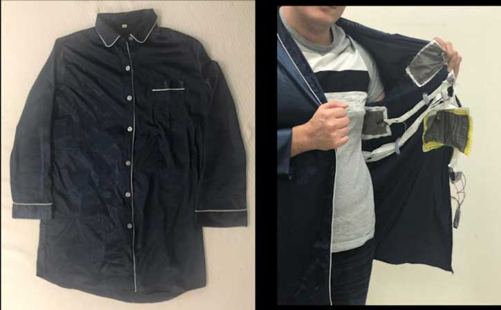 A researcher shows the sensor patches in a pajama shirt.