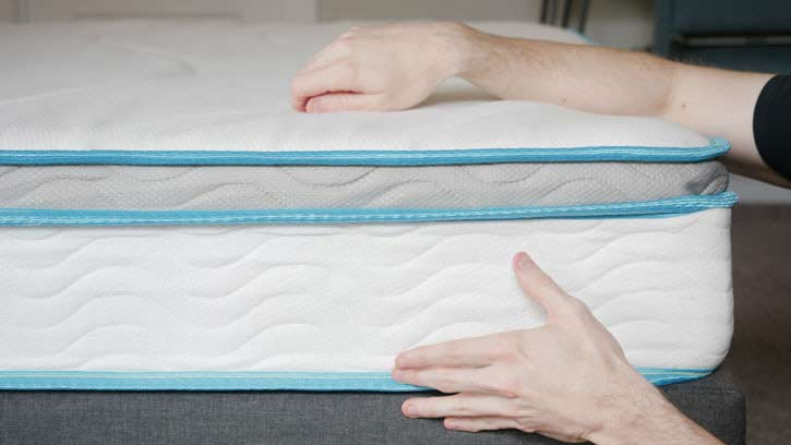 The side of a hybrid mattress.