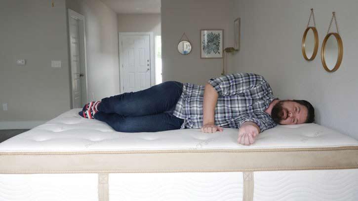 A man sleeps on his side.