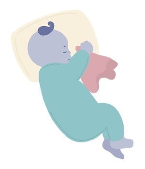 baby sleeping with a lovey and small pillow