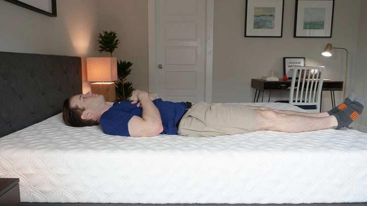 A man sleeps on a memory foam mattress.