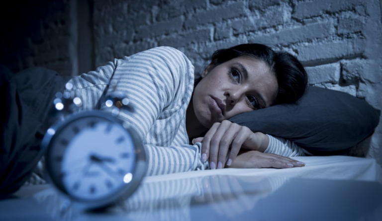 Woman with anxiety can't sleep