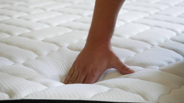 Pushing into a hybrid mattress