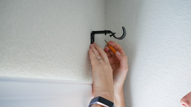 Use your mounting bracket and pencil to mark the spot where you'll drill a hole for the screw