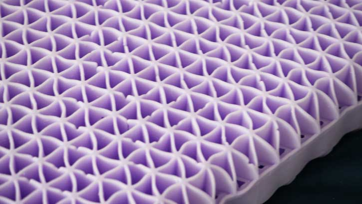 Purple's pillow core is Smart Comfort Grid made with their Hyper-elastic Polymer