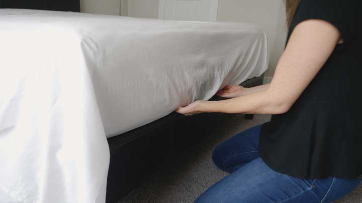 To make hospital corners you need to tuck the flat sheet into the foot of the bed