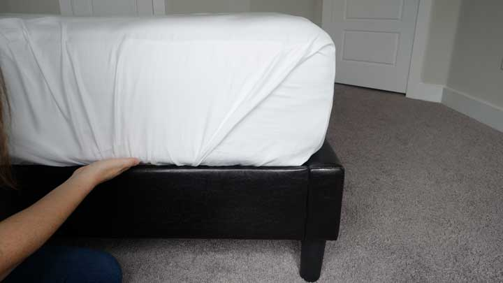 tuck the final piece of flat sheet into your mattress to create a hospital corner
