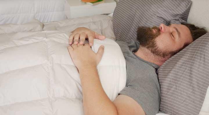 Back Sleeping Under Comforter