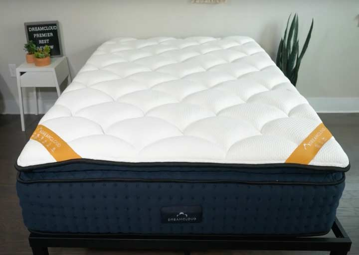 A wide shot of the DreamCloud Premier rest mattress on a bed frame
