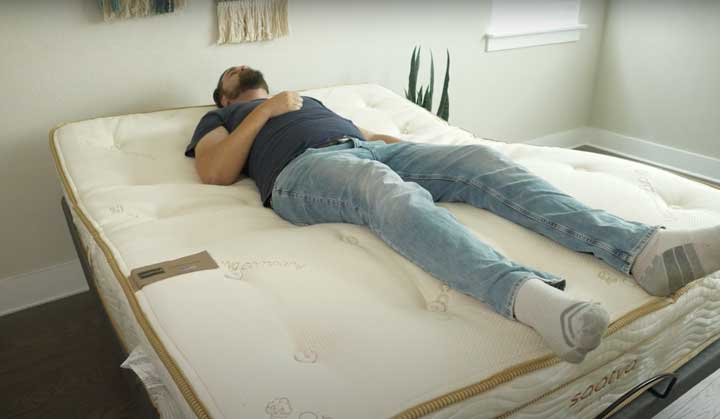 A man tests out the Zero Gravity function of the Saatva Lineal Base