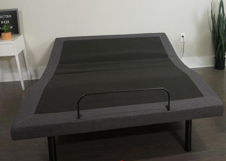 A wide shot of the Nectar Adjustable Base sitting in a bedroom.